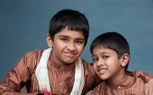 foto of salwar  - two handsome indian brothers looking happy with traditional attire - JPG