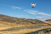 FORT COLLINS, CO, USA, September 30 2014:  Airborne radio controlled DJI Phantom quadcopter drone with Panasonic Lumix GM1 camera  is flying over Pineridge Natural Area at Colorado foothills.