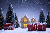 winter scene with Christmas tree,miniature of apartment and gift boxes.Christmas concept.