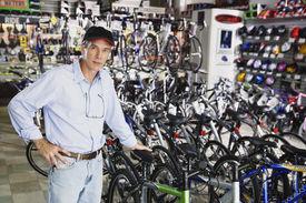 picture of flogging  - Portrait of man standing in bike shop - JPG