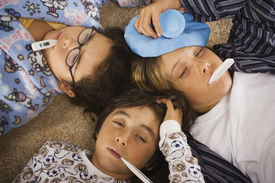 picture of pre-adolescent child  - Group of sick children in pajamas on the floor - JPG