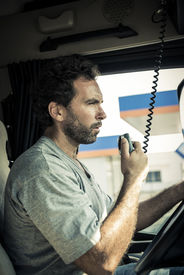 pic of truck-stop  - Portrait of a truck driver using CB radio - JPG
