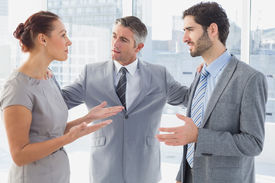 stock photo of half-dressed  - Businesswoman arguing with co - JPG