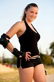Girl with safety pads un black sport outfit