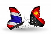 image of papua new guinea  - Two butterflies with flags on wings as symbol of relations Thailand and Papua New Guinea - JPG