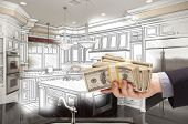 Hand Holding Stacks of Money Over Custom Kitchen Design Drawing and Photo Combination.