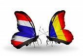 stock photo of chad  - Two butterflies with flags on wings as symbol of relations Thailand and Chad Romania - JPG