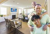 stock photo of rebuilt  - Happy Young African American Family In Their Living Room - JPG