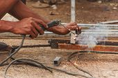 Hands and arc welder