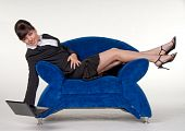 Sexy secretary in blue sofa