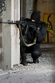 picture of extremist  - Armed criminal shooting with automatic rifle form covered position - JPG