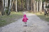 Spring In The Forest Little Girl Walking Along The Road.