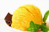 foto of gelato  - Scoop of yellow ice cream garnished with chocolate curls - JPG