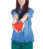 Love and Valentine's Day beautiful brunette holding a red heart in hands isolated on white backgroun