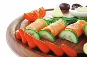 red smoked salmon slices with vegetables and lemon
