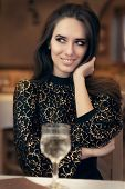 Beautiful Elegant Woman Sitting in a Restaurant