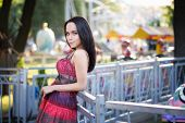 Young attractive girl in the amusement park