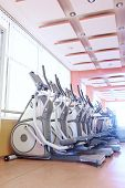 picture of elliptical  - Elliptical cross trainer in a row in a gym  - JPG