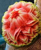 stock photo of carving  - holiday table watermelon carved in the style of carving - JPG