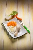 boiled chicken leg wit fennel and carrot salad