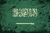 Saudi Arabian flag. Grunge background. Vector illustration