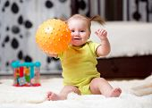 stock photo of indoor games  - toddler kid playing with ball indoors at home - JPG