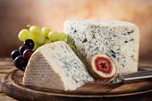 Blue cheese on wooden table, still-life.