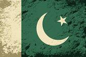 Pakistani flag. Grunge background. Vector illustration