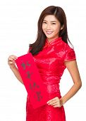 Asian woman hold with Fai Chun, phrase meaning is happy new year
