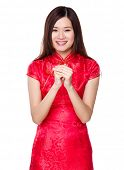 Chinese woman with congratulation gesture