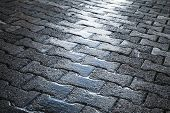 Shining Wet Cobblestone Pavement, Urban Road
