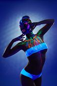 Fantastic girl with bright luminous body art