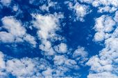 clouds in the blue sky as a symbol of freedom, fantasy, good air