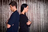 Couple not talking after argument against wooden planks