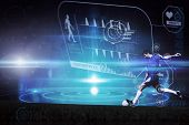 Football player kicking ball against futuristic shiny black background