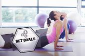 foto of cobra  - The word set goals and fit women doing the cobra pose in fitness studio against hexagon - JPG