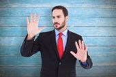 Businessman showing something with his hands against wooden planks