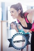 The word stretch and people doing power fitness exercise at yoga class against badge