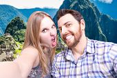 Beautiful Couple taking a selfie photo in Machu Picchu, Peru