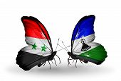 Two Butterflies With Flags On Wings As Symbol Of Relations Syria And Lesotho