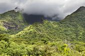 Tahiti. Polynesia. Clouds over a mountain landscape.