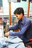 Portrait of two indian man tailor at work place with sewing machine