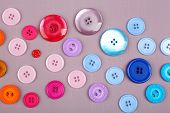 Colorful buttons on wooden background