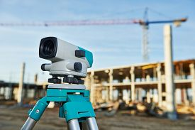 pic of geodesic  - Surveyor equipment optical level outdoors at construction site - JPG