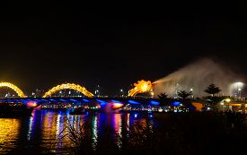 stock photo of gushing  - Dragon Bridge Night view gush water Danang - JPG
