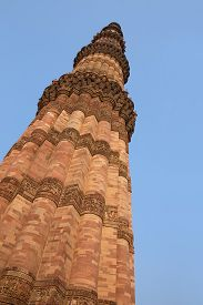 picture of qutub minar  - Qutub Minar tower against blue sky Delhi India - JPG