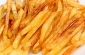 pic of french fries  - Heap of french fries fried in oil deep fried unhealthy and caloric food - JPG