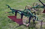 pic of plowing  - Old iron plow - JPG