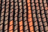 foto of red roof  - Red roof tile pattern over blue sky - JPG