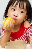 pic of southeast asian  - Asian Chinese little girl eating durian fruit - JPG